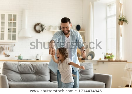 young pretty modern family at home happy smiling, lifestyle peop Stock photo © iordani