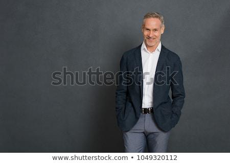 caucasiano · homem · bonito · em · pé · isolado · cinza · parede - foto stock © deandrobot