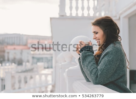 happy woman with cup or mug drinking at home Stock photo © dolgachov