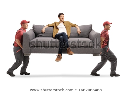 Three young men lounging on couch Stock photo © IS2