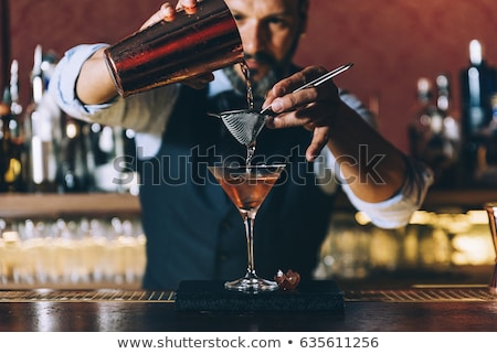 Male bartender mixing drinks Stock photo © IS2