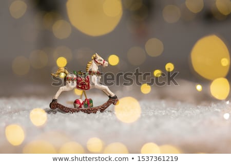 Vintage toy horse with Christmas lights stock photo © dariazu