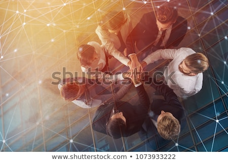 business people joining hands in the office concept of teamwork and partnership double exposure stock photo © alphaspirit