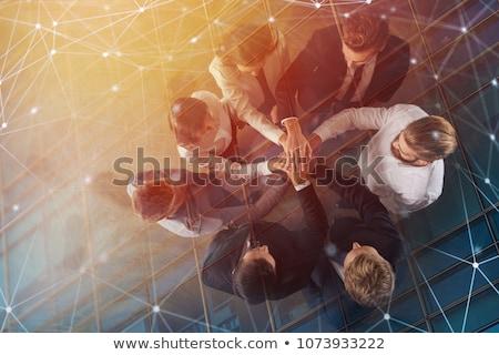 Gente de negocios manos oficina trabajo en equipo doble Foto stock © alphaspirit
