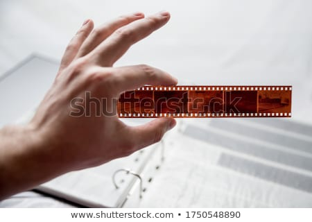 Hands holding 35mm colour film strip Stock photo © RTimages
