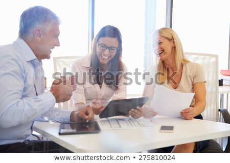 Three colleagues laughing Stock photo © IS2