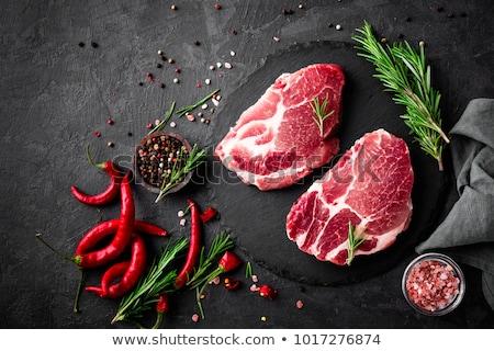 Pork meat, grilled steak on black background, top view Stock photo © yelenayemchuk