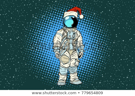 Christmas lone astronaut in the Santa hat Stock photo © studiostoks