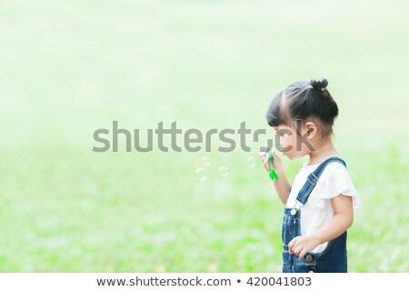 Lány buborékfújás búzamező jókedv szabadság mezőgazdaság Stock fotó © IS2