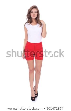 Kadın kırmızı yüksek topuklu şort gömlek poz Stok fotoğraf © feedough