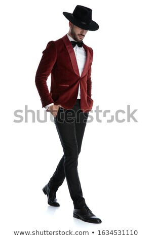 young fashion man in tuxedo walks and looks down  Stock photo © feedough