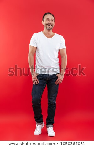 Handsome cheerful mature man. Looking aside. Stock photo © deandrobot