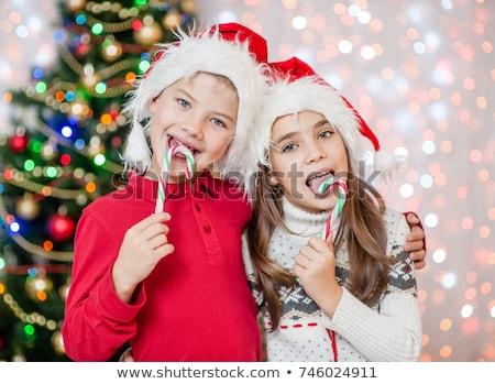 kaukasisch · weinig · jongen · christmas · snoep - stockfoto © rastudio