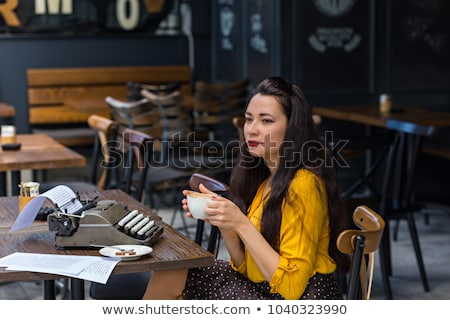 woman wearing blank white shirt and black skirt stock photo © sumners