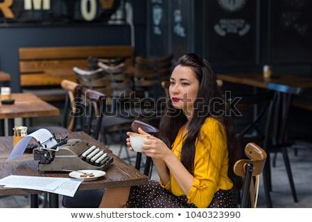 Stock photo: Woman wearing blank white shirt and black skirt