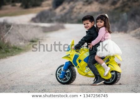 Fivér lánytestvér ül motorbicikli portré mosolyog Stock fotó © Kzenon