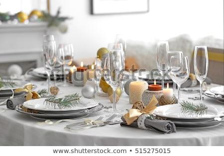 Christmas table setting with candles and xmas gift Stock photo © karandaev