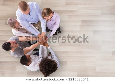 Group Of Businesspeople Stacking Their Hands Stock photo © AndreyPopov