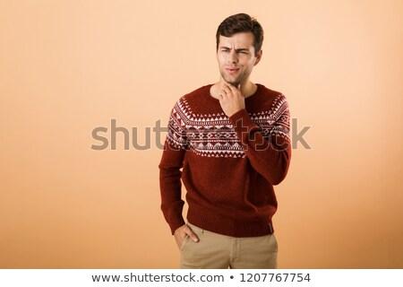 Immagine sorpreso uomo 20s setola indossare Foto d'archivio © deandrobot
