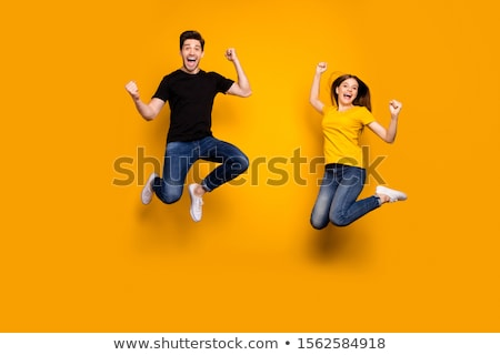 young couple jumping in air stock photo © kzenon
