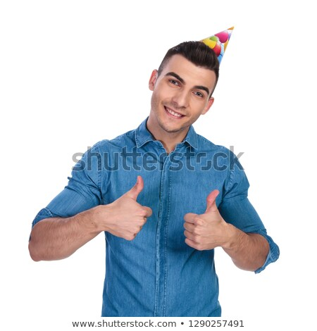 young casual man wearing birthday hat makes ok sign stock photo © feedough
