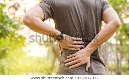 sebes · hát · hátulnézet · fiatalember · megérint · kéz - stock fotó © lightsource