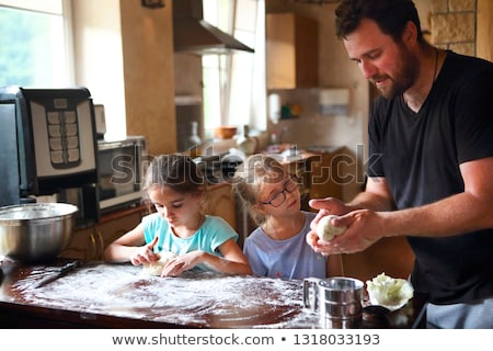 Children cooking homemade bread with there father Stock photo © dashapetrenko