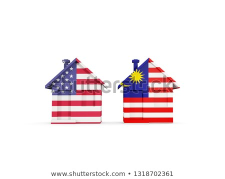 Two houses with flags of United States and malaysia Stock photo © MikhailMishchenko