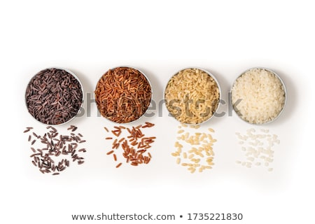 Red bowl of raw organic basmati rice on white background. Healthy food. Top view Stock photo © DenisMArt
