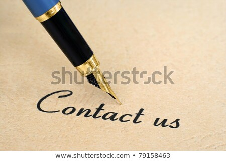 Contact Us Handwritten With White Marker Stock photo © ivelin