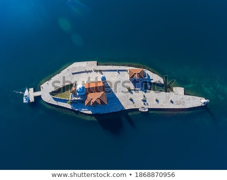 Lonely Mediterranean stone island aerial view stock photo © xbrchx
