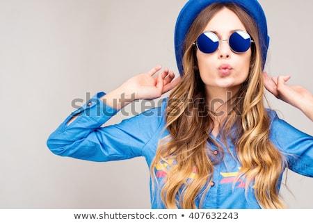 bastante · nina · gafas · de · sol · mirando · cámara · retrato - foto stock © studiolucky