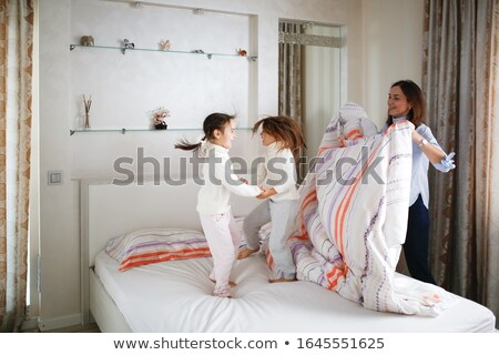 Sister Bedding in the Morning Stock photo © colematt