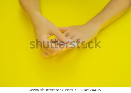 Woman Hands Care. Varnish removal Small nail art and manicure business. Top View Of Beautiful Smooth Stock photo © galitskaya