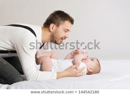 отец · ребенка · дочь · кровать · женщину - Сток-фото © Lopolo