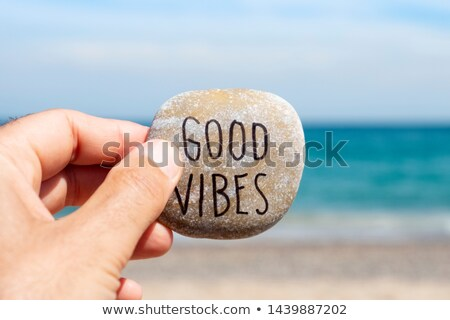 text good vibes in a stone on the beach stock photo © nito
