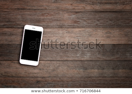 Smartphone on wood table Stock photo © magraphics