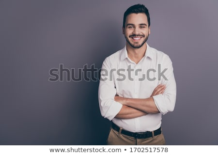 Smiling confident bearded man with folded arms Stock photo © Giulio_Fornasar