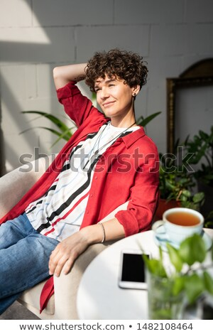 Serene and satisfied woman in stylish casualwear relaxing in armchair Stock photo © pressmaster