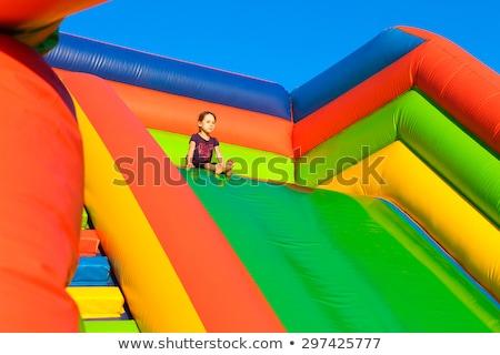 Dziewczynka nadmuchiwane slajdów sportu dziecko chłopca Zdjęcia stock © galitskaya