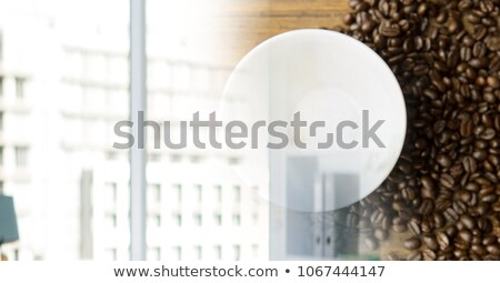 Overhead of coffee cup with beans and blurry window transition Stock photo © wavebreak_media