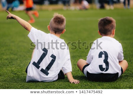 Stock fotó: Kettő · fiatal · fiúk · futball · sportruha · ül