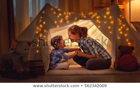 happy family playing with toy in kids tent at home Stock photo © dolgachov