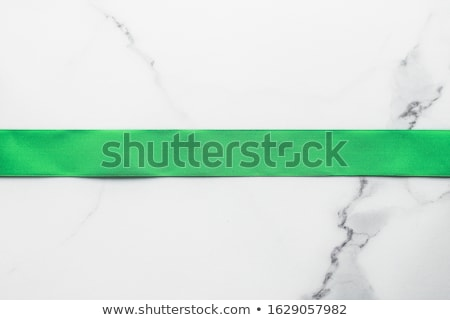 green silk ribbon and bow on marble background st patricks day stock photo © anneleven