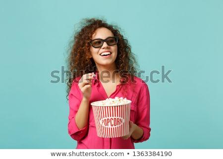Glimlachend Rood tienermeisje eten popcorn fast food Stockfoto © dolgachov