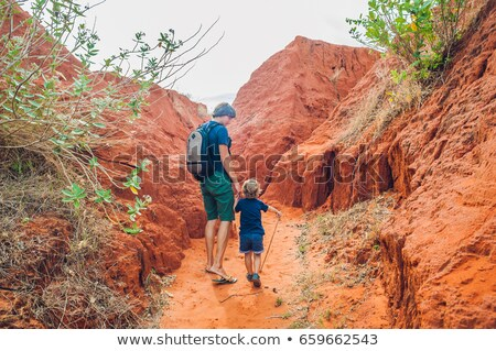 father and son travelers in red canyon near mui ne southern vietnam traveling with children concep stock photo © galitskaya