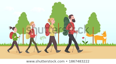 Family in hiking. Mom and son walking in the forest with trekking sticks Stock photo © galitskaya