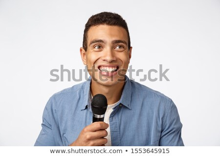 Close-up portrait look upper right corner joyful, laughing and smiling, perform stand-up or singing  Stock photo © benzoix