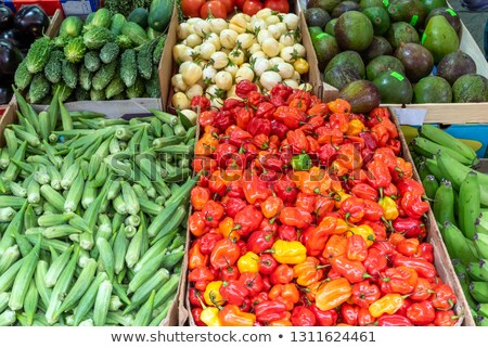 Mini bell peppers, pickles and peas Stock photo © elxeneize