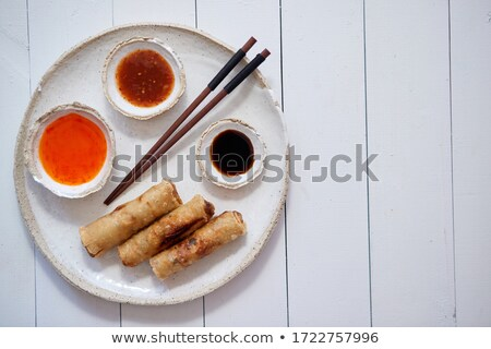 Fried Chinese Thai or Vietnamese traditional spring rolls or nems served on ceramic plate Stock photo © dash